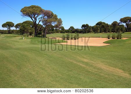 Golf course with sand trap.