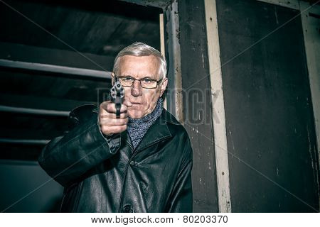Dangerous Senior Aiming A Gun