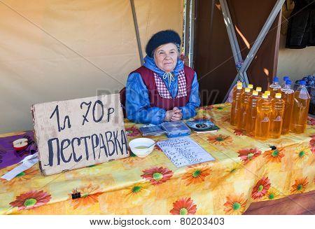 Women Seller Of Sunflower Oil On The Traditional Farmers Market