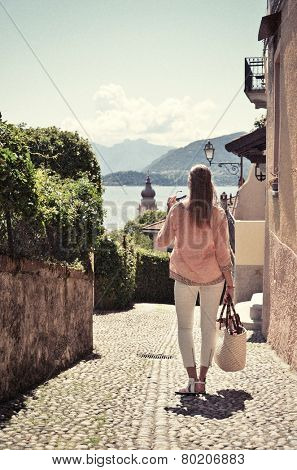 Girl on the cobbled street of Menaggio town. Lake Como, Italy -- retro nostalgic filtered look