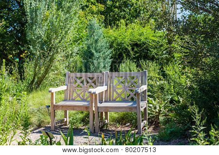 Two Wooden Chairs In Green Garden