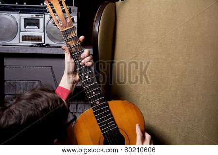 Man Takes Guitar.