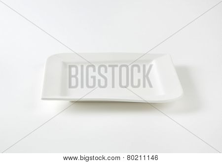 empty white square plate on white background