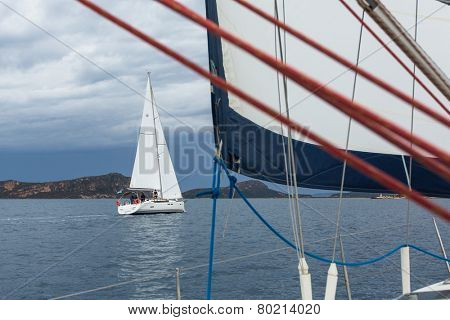 ZAKYNTHOS - PYLOS, GREECE - OCT 5, 2014: Unidentified sailboats participate in sailing regatta 12th Ellada Autumn-2014 on Aegean Sea.