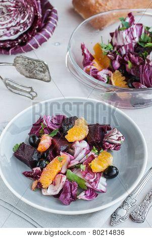 Beet, Orange, Radicchio, Olives Salad. Selective Focus