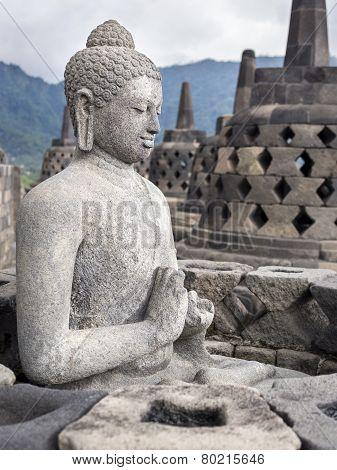 Ancient Buddha Statue At Borobudur Temple Ruins, Yogyakarta, Java, Indonesia