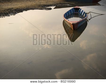 Rowboat Floating On Still Water