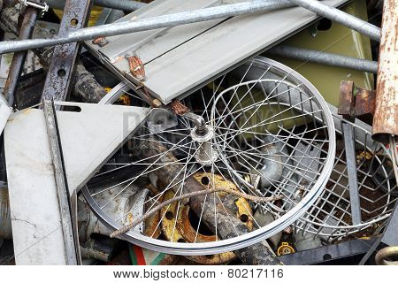 Part Of A Bicycle In The Container Of Scrap Metal