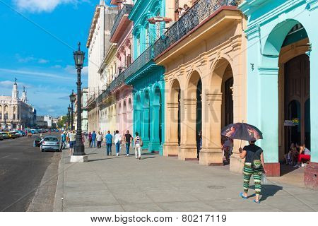 HAVANA, CUBA - JANUARY 8, 2015 : Street scene with colorful buildings on a sunny day in Old Havana