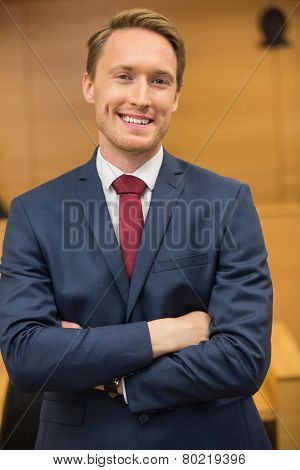 Smiling lawyer looking at camera in the court room