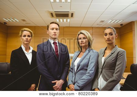 Portrait of four well-dressed lawyer in the court room