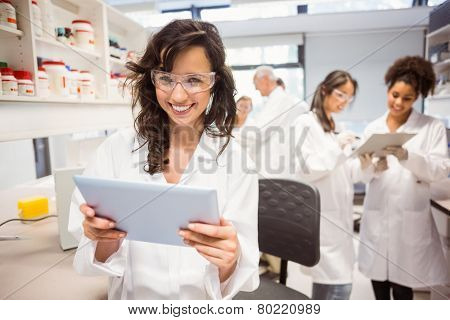Science student holding tablet pc in lab at the university