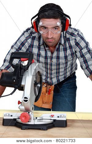 Man using band-saw