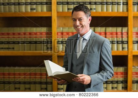 Lawyer holding book in the law library at the university