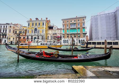 Water Channell With Gondolas In Venice