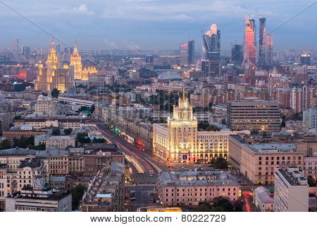 MOSCOW, RUSSIA - AUG 30, 2014: Cityscape with Stalinist skyscraper on Kudrinskaya street and Hotel Ukraina at night