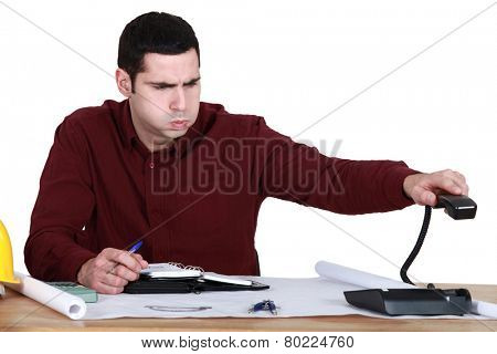 Stressed man hanging up the phone