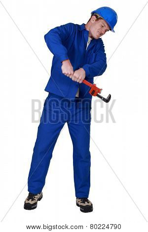 Plumber using a pipe wrench