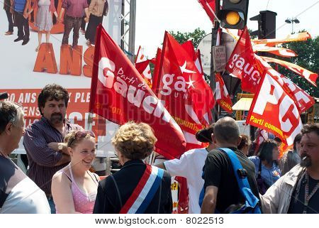 Protesters standing in front of a banner at a street demonstration in Paris, France on June 24, 2010