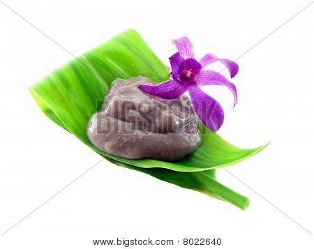 Poi On A Tea Leaf With An Orchid