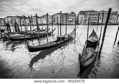 Gondola Moored At Dock In Venice