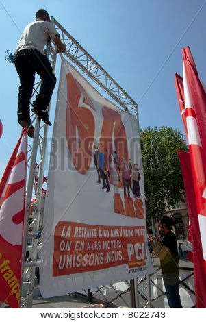 Man hanging a banner during a street demonstration in Paris, France