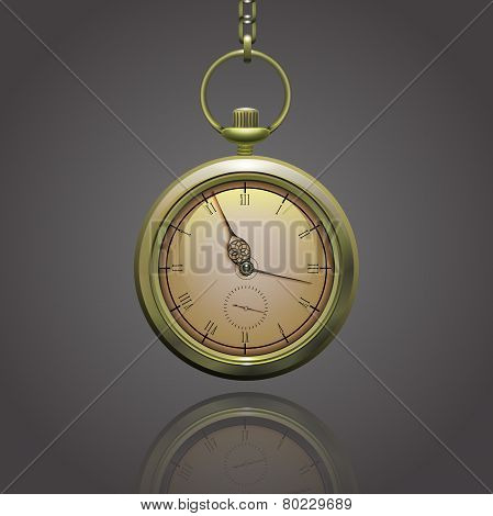 Gold vintage pocket clock on a chain with roman numerals