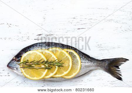 Fresh Dorado Fish On Wooden Board