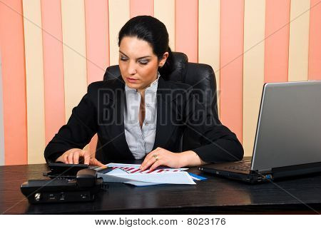 Corporate  Woman Using Calculator
