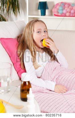 Sick child Licking Lemon