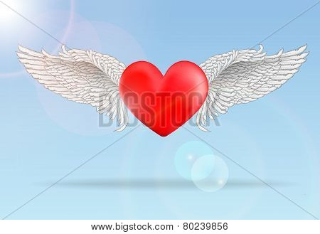 Realistic red flaying heart with white wings