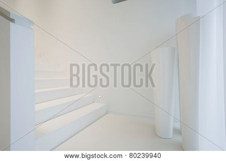 White Staircase Inside Pure House