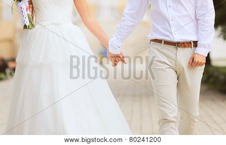 Abstract Wedding Photo Couple Bride And Groom Holds Hands Walks Outdoors