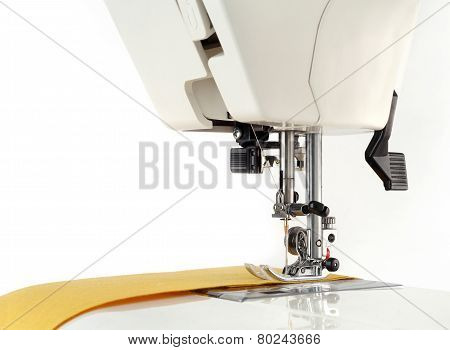 Sewing machine and fabric on a white background.