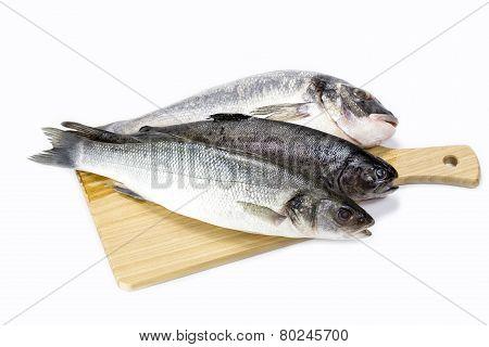 raw fish on a cutting board