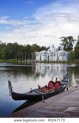 Venetian gondola on the bank of Big pond and pavilion