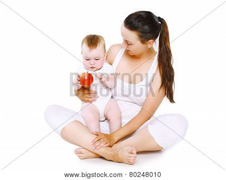 Baby And Food Concept - Mother Holding Baby With Apple