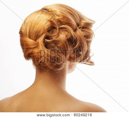 Portrait of blond woman with elegant hairstyle.