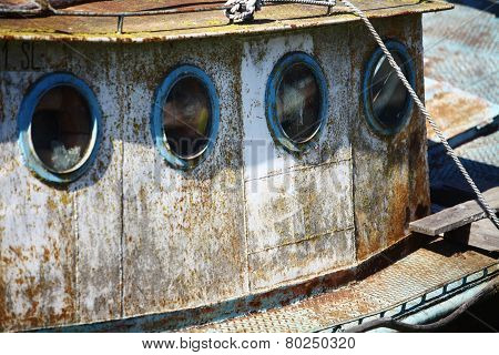 Portholes On An Old Ship