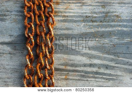 rusty chains on wood background