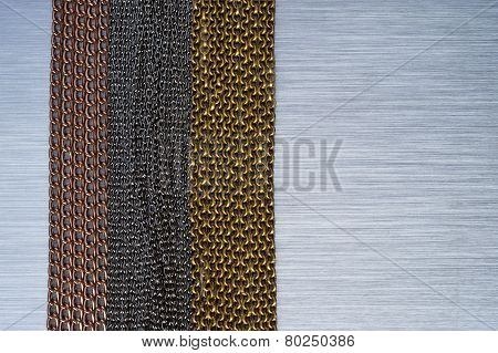 chains on brushed metal background
