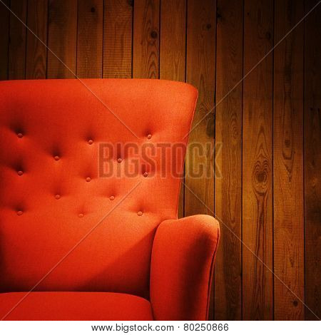 Classic Red Armchair Near A Wooden Wall