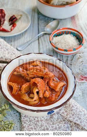 Tripe soup with tomatoes. Italian cuisine.