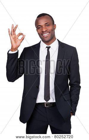 Gesturing Ok Sign.