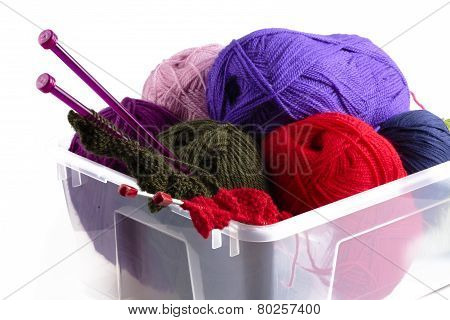 Plastic Box With Knitting Needles And Wool