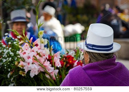 Indigenous woman selling flowers in Plaza de Flores Cuenca Ecuador