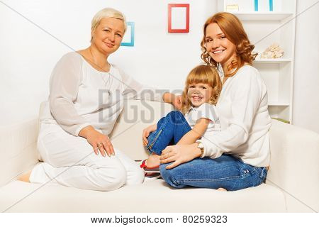 Family on sofa with mom girl and granny