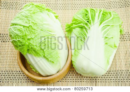 Chinese Cabbage In Wooden Bowl On Mat Background