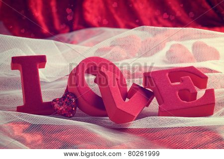 Love with heart decoration on bridal veil