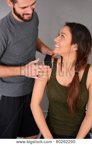 Woman working out at the gym with a personal trainer